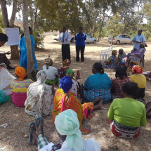 Kitui Branch Manager Mr. Joseph Musyimi conducts savings education to a women's group