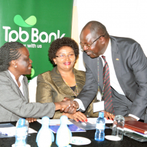From Left: Ms Esther Koimett, EBS - Director General Public Investment and Portfolio Management, National Treasury, Ms. Anne Karanja –Managing Director Postbank and Dr. Habil Olaka - CEO Kenya Bankers Association (KBA) exchange greetings during the 2017 Association of Savings Bank of East Africa (ASBEA) conference in Nairobi.
